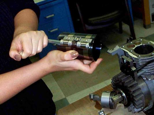 Using a piston ring compressor